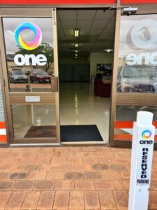 Image of front doors with logo of One Central Health in Kalgoorlie
