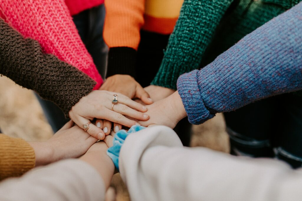 Group putting their hands in the middle